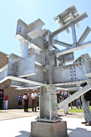 People gather to watch as they reveal the structural steel teaching sculpture on May 1, 2015.